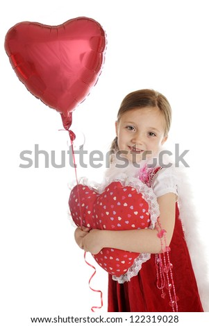 A beautiful elementary girl with valentine beads and a fluffy white boa.  She carries a lace-trimmed, heart shaped pillow and holds the string of a floating valentine balloon.  On a white background.