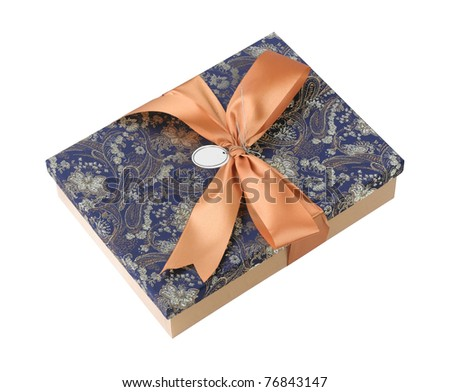 A  beautiful fabric gift box with red ribbon - stock photo