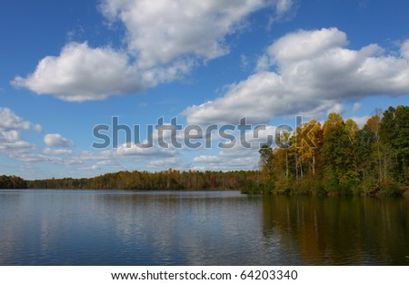 A beautiful fall water scape of Beaverdam Reservoir in Gloucester Virginia with a gorgeous sky and room for your text - stock photo
