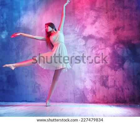 A beautiful female ballet dancer - stock photo