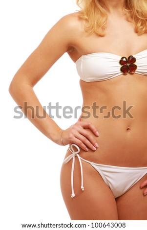 A beautiful female body wearing swimsuit, isolated on white background - stock photo