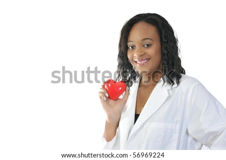 A beautiful female doctor holding a heart - stock photo