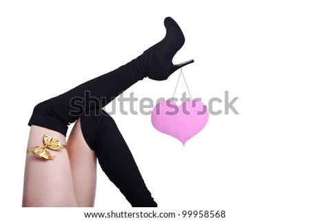 a beautiful female legs with pink heart and yellow ribbon