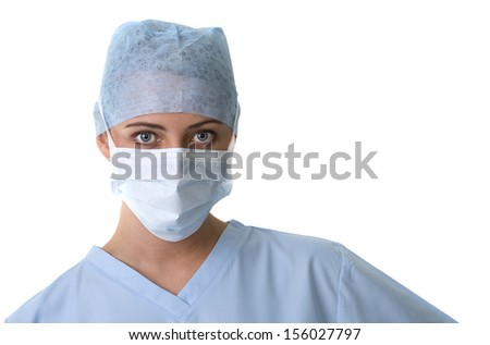 A beautiful female nurse or surgeon in scrubs, cap and mask, isolated on white