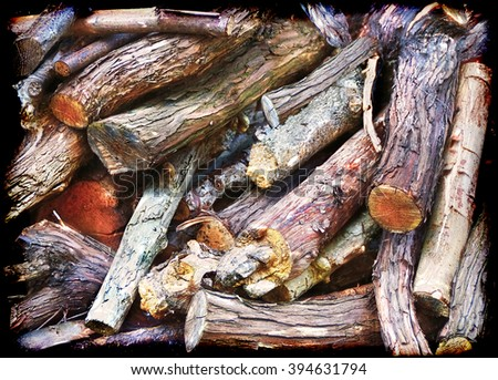 A beautiful framed closeup of logs in a woodpile - stock photo