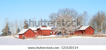 A beautiful frosty landscape in winter with red houses - stock photo