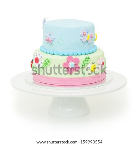A beautiful garden themed children's birthday cake - stock photo