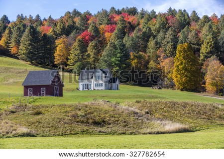 A beautiful generic New England country building in the fall - stock photo