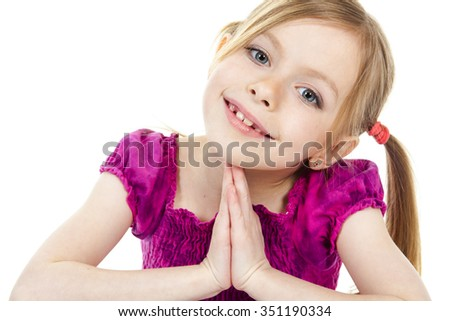 A beautiful girl child wearing a pink clothe and sit on the floor over a white background. - stock photo