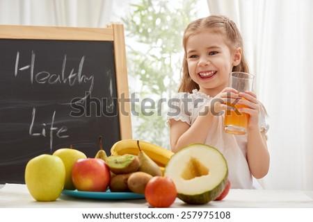 A beautiful girl drinking fresh juice - stock photo