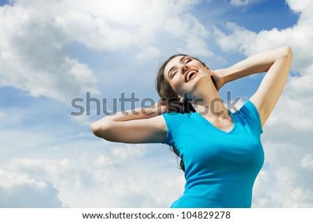 A beautiful girl enjoying summer sun - stock photo