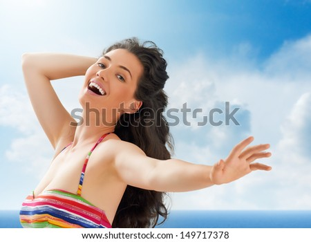 A beautiful girl enjoying summer sun - stock photo
