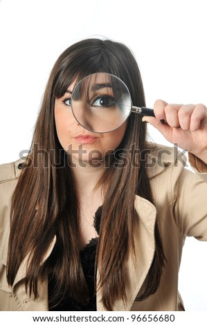 a beautiful girl holds a magnifying lens - stock photo
