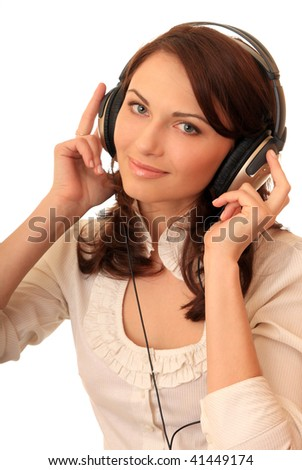 A beautiful girl in headsets listens music. - stock photo