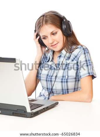 a beautiful girl is listening to the music and looking at a laptop. isolated on white background