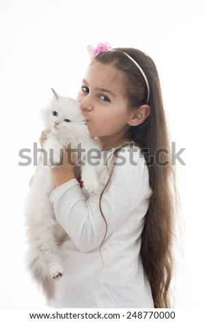 A Beautiful Girl Kissing Her Cat Isolated on White Background - stock photo