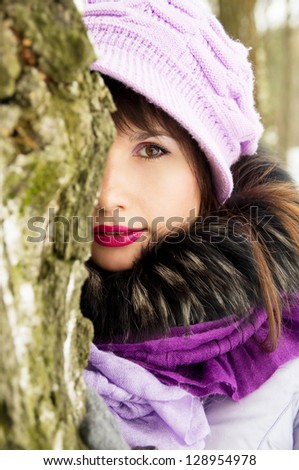 A beautiful girl on the nature in winter