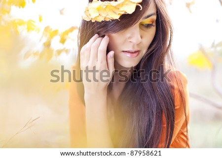 a beautiful  girl posing in an autumn setting
