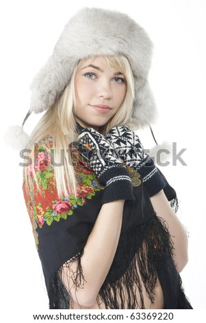 A beautiful girl posing in fur hat,  and bright scarf