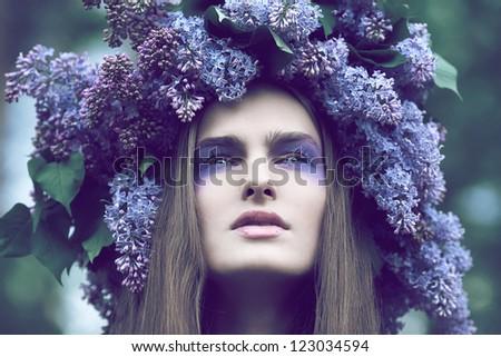 A beautiful girl posing in the garden - stock photo
