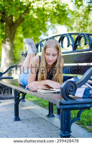 a beautiful girl walks and engaged in self-education preparing for admission to the University