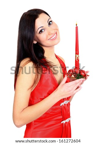 A beautiful girl with a candle. - stock photo