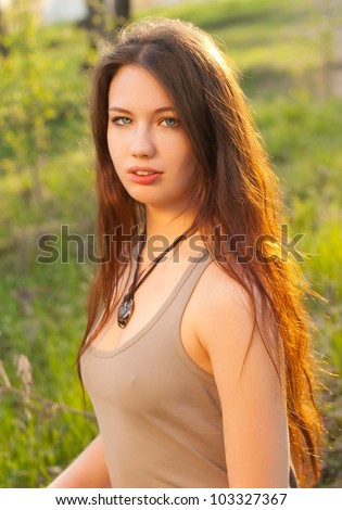 A beautiful girl with long hair outdoors