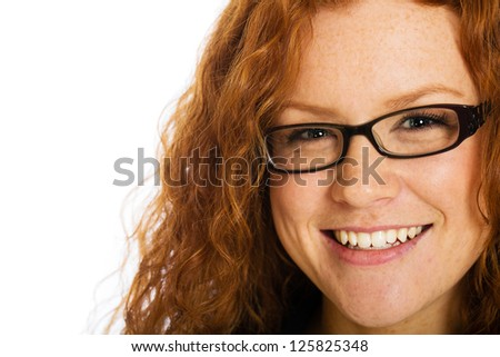A beautiful girl with naturally curly red hair and freckles.