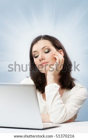 A beautiful girl working in a laptop