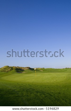 a beautiful green in a golf course - stock photo