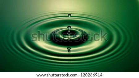 A beautiful green water drop - stock photo