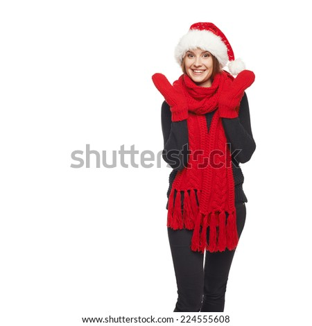 A beautiful happy surprised Christmas woman wearing santa hat and red scarf and mittens over white background - stock photo