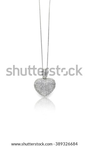 A beautiful heart shaped pave diamond and white gold or silver pendant dangles from a chain. Fine Jewelry necklace isolated on a white background with shadow and reflection - stock photo