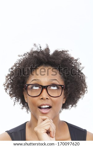A beautiful intelligent mixed race African American girl or young woman looking up happy thoughtful surprised and wearing geek glasses