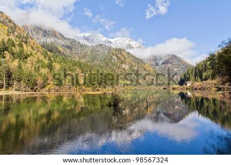 A beautiful lake in autumn - stock photo