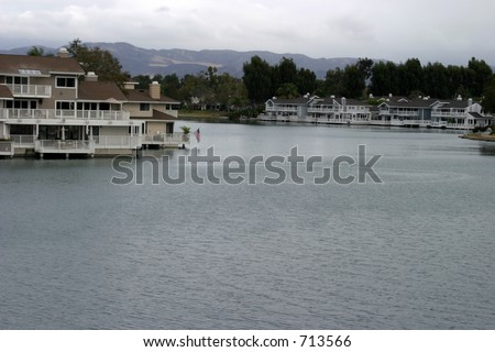 a beautiful lake with homes on the water