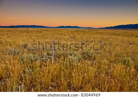 A beautiful landscape photograph of the Nevada desert and mountains at sunset.