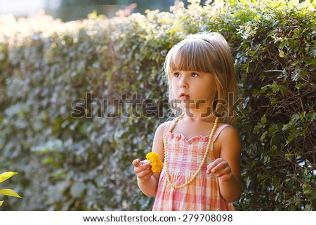 a beautiful little girl on nature  - stock photo
