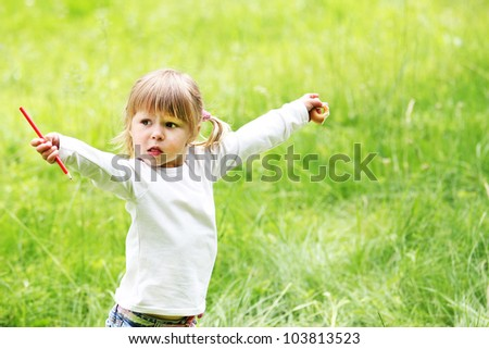 a beautiful little girl on the nature