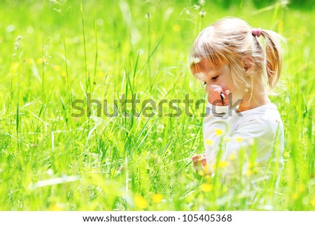 a beautiful little girl on the nature of - stock photo