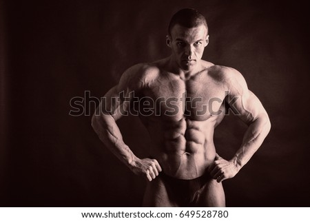 A beautiful man's pumped body. The concept of bodybuilding
