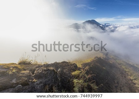A beautiful misty trail on the steep edge of the caldera on Mount Batur on Bali, Indonesia.