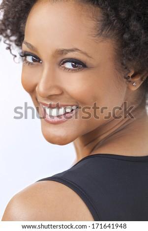 A beautiful mixed race African American girl or young woman looking happy and smiling with perfect teeth