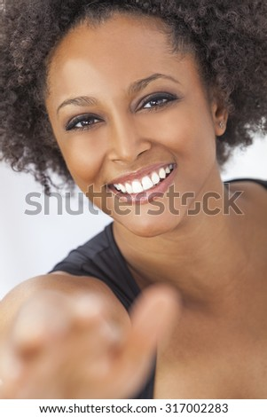 A beautiful mixed race African American girl or young woman with perfect teeth taking selfie photograph