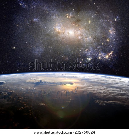 A beautiful nebula (the irregular galaxy, NGC 4449) over the Earth. Elements of this image furnished by NASA.  - stock photo