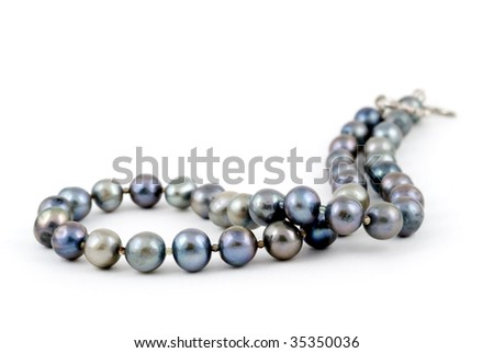 A beautiful necklace made of pearls of the Andaman sea of the coast of Thailand, on a white background.