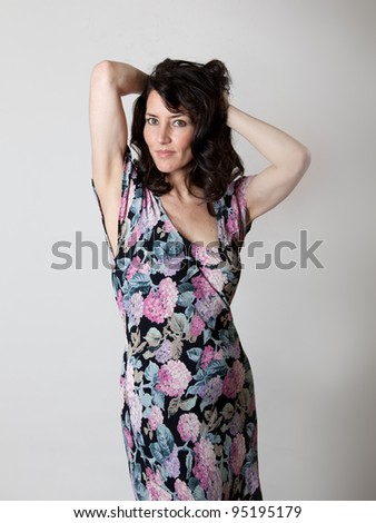 A beautiful older woman in a flower summer dress