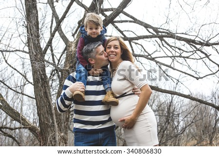 A beautiful outdoor pregnant couple portrait in autumn nature