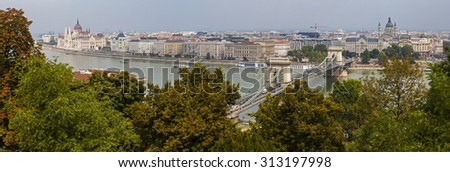 A beautiful panoramic view from Castle Hill taking in the sights of the Hungarian Parliament Building, the Chain Bridge, St. Stephens Basilica and the River Danube in Budapest, Hungary. - stock photo