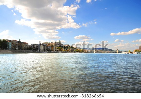 A beautiful panoramic view of Budapest from the Danube river in a cloudy blue sky - stock photo